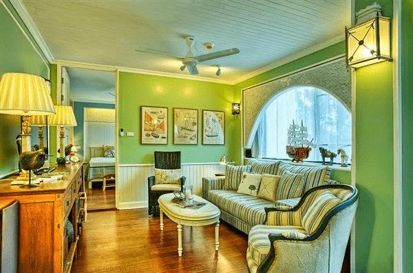 Gam màu xanh lá đem lại sự trẻ trung, hiện đại cho phòng khách